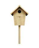 Wooden bird house on a pole  on a white background. Fron Royalty Free Stock Photo