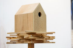 Wooden bird house on a pole. On white stock image