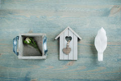 Wooden bird house, rose on blue Stock Photography
