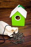 Wooden bird house with seed Royalty Free Stock Photos