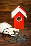 Wooden bird house with seed Stock Photo