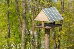 Wooden Bird house on a tree in the park. Bird house on a tree in the park or forest stock photography