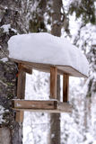 Wooden bird table in winter and snow Royalty Free Stock Image