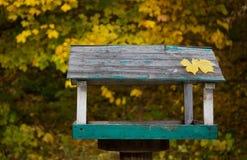 Wooden bird trough Stock Photos
