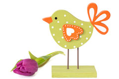 Wooden bird with tulip Stock Photography