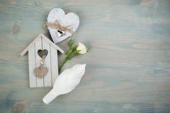 Wooden birdcage, bird, rose, heart. Stock Image