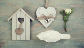 Wooden birdcage, bird, rose, heart. Stock Photo