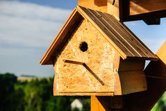 Wooden birdhouse in the countryside Royalty Free Stock Photo