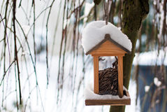 Wooden birdhouse covered with snow Royalty Free Stock Photos