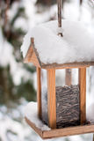 Wooden birdhouse covered with snow Royalty Free Stock Images