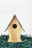 Wooden birdhouse. With grass on white background Royalty Free Stock Photography