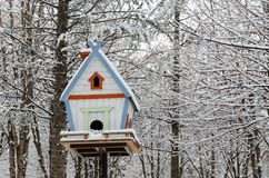 Wooden birdhouse in the park stock photo