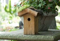 Wooden Birdhouse with Plants and Flowers stock image