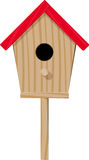 Birdhouse. Wooden birdhouse with a red roof view from the entrance side Royalty Free Stock Photo