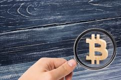 Wooden Bitcoin on a background of black boards. Crypto currency. Blocking technology. The collapse and rise in the cost of bitcoin. Mining farms, miners, stock royalty free stock photos