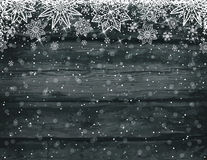 Wooden black christmas background with snowflakes stock image