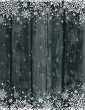 Wooden black christmas background with snowflakes royalty free stock images