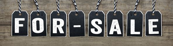 Wooden black hang tags with for-sale stock photo