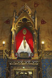 Wooden Black Madonna inside of church of Notre Dame in Rocamadour, France Royalty Free Stock Image