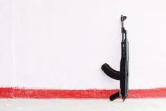Wooden black toy Kalashnikov rifle Stock Images
