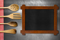 Wooden Blackboard and Kitchen Utensils Royalty Free Stock Images