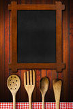 Wooden Blackboard and Kitchen Utensils Stock Images