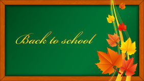 Wooden blackboard with leaves Stock Photo