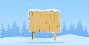 Wooden blank board in snow Stock Photos