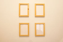 Wooden blank picture frame , Photo art gallery on the wall. Royalty Free Stock Photos