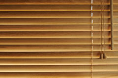 Wooden blinds background. Closed wooden blinds with bright light coming through background Royalty Free Stock Photos