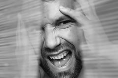 Through wooden blinds the man looks. Through the wooden blinds, a man with a beard looks Royalty Free Stock Photos