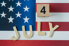 wooden block and alphabet as 4 July with United State national f Royalty Free Stock Photography