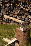 Wooden block with ax and split wood Stock Photos