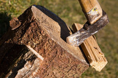 Wooden block with ax and split wood, closeup Stock Photography
