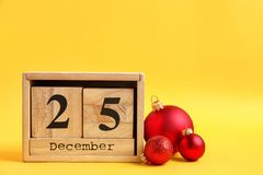 Wooden block calendar and decor. On color background. Christmas countdown royalty free stock image