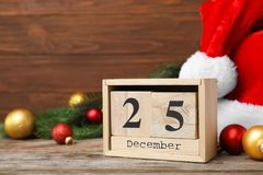 Wooden block calendar and decor. On table. Christmas countdown stock photo