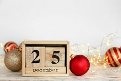 Wooden block calendar and festive decor on table. Christmas countdown. Wooden block calendar and decor on table. Christmas countdown royalty free stock photography