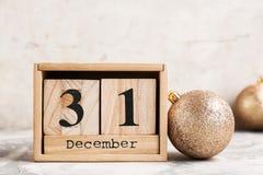 Wooden block calendar and decor on table. Christmas countdown royalty free stock photos