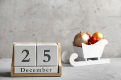 Wooden block calendar and decor on table. Christmas countdown. Wooden block calendar and festive decor on table. Christmas countdown stock photography