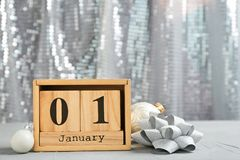Wooden block calendar and decor on table. Christmas countdown. Wooden block calendar and festive decor on table. Christmas countdown royalty free stock images