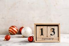 Wooden block calendar and decor on table. Christmas countdown stock photos