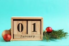 Wooden block calendar and decor. On color background. Christmas countdown royalty free stock photos