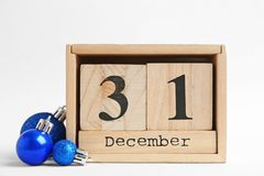 Wooden block calendar and decor. On white background. Christmas countdown stock images