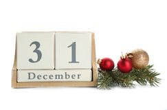 Wooden block calendar and decor. On white background. Christmas countdown royalty free stock photography
