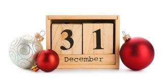 Wooden block calendar and decor. On white background. Christmas countdown stock photos