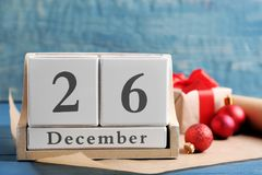 Wooden block calendar and decor on table. Christmas countdown. Wooden block calendar and festive decor on table. Christmas countdown royalty free stock photography