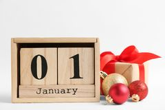 Wooden block calendar and decor on white background. Christmas countdown. Wooden block calendar and festive decor on white background. Christmas countdown stock images