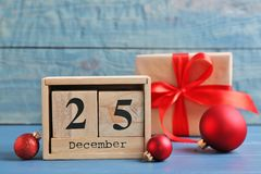 Wooden block calendar, gift box and decor on table. Christmas countdown. Wooden block calendar, gift box and festive decor on table. Christmas countdown royalty free stock photo