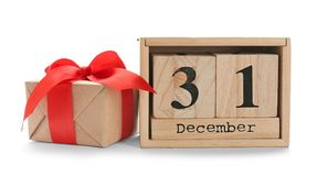 Wooden block calendar and gift box on white background. Christmas countdown. Wooden block calendar and small gift box on white background. Christmas countdown stock photos