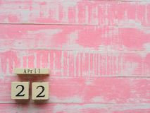 Wooden Block calendar for World Earth Day April 22, bright pink stock photo